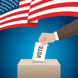 USA presidential election day concept. Hand putting voting paper Stock Images