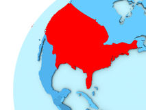 USA in red on blue globe. USA in red on simple blue political globe. 3D illustration Royalty Free Stock Images