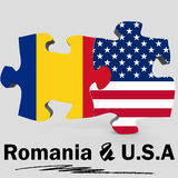 USA and Romania flags in puzzle Stock Photography