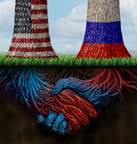 USA Russia Cooperation. And partnership business and diplomatic concept of working together for common interests as two growing trees with flags painted on with Stock Photo