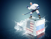 USA - Russia game  Spunky hockey player on ice cube Stock Photography