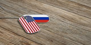 USA and Russia military relations, Identification tags on wooden background. 3d illustration. USA and Russia military relations, Identification dog tags on Royalty Free Stock Photo