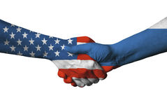 Usa and Russian flag across handshake. Royalty Free Stock Photo