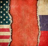 USA and Russian torn paper flags. Break of diplomatic relations. Stock Images
