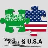 USA and Saudi Arabia flags in puzzle Royalty Free Stock Photos