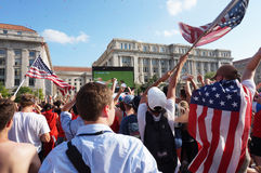 USA Scores a Goal. Photo of fans raising american flags at  freedom plaza in washington dc during the world cup soccer game pitting belgium against the usa on 7/ Royalty Free Stock Photography
