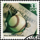 USA - 2000: shows Baseball and Newspaper Headline, devote New records, series Celebrate the Century, 1990s. UNITED STATES OF AMERICA - CIRCA 2000: A stamp Royalty Free Stock Photos