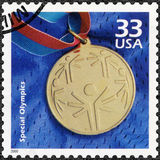 USA - 2000: shows Olympic gold medal, devote Special Olympic, series Celebrate the Century, 1990s. UNITED STATES OF AMERICA - CIRCA 2000: A stamp printed in USA Stock Photography