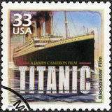 USA - 2000: shows Poster for Titanic, 1997, devote blockbuster film, series Celebrate the Century, 1990s. UNITED STATES OF AMERICA - CIRCA 2000: A stamp printed Stock Photo