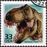 USA - 2000: shows Tyrannosaurus rex, devote Jurassic Park film, 1993, series Celebrate the Century. UNITED STATES OF AMERICA - CIRCA 2000: A stamp printed in USA Stock Image