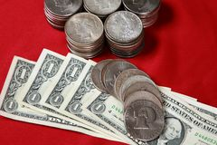 USA silver dollar bills and silver coins Royalty Free Stock Photo