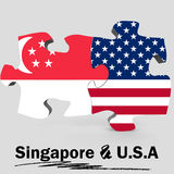 USA and Singapore flags in puzzle Stock Photography
