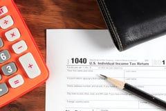 USA-skattform 1040 på tabellen Royaltyfri Bild
