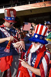 USA Soccer Supporters - FIFA WC. USA fans all dressed up in fancy dress costume to show support for their team at the 2010 FIFA soccer world cup. Clutching a stock photography