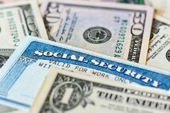 USA social security cards and dollar bills stock images