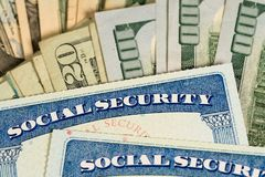 USA Social Security Cards Laid On Dollar Bills Stock Photo