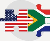 USA and South Africa Flags in puzzle Stock Photos