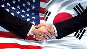 USA and South Korea handshake, international friendship flag background, finance. Stock photo royalty free stock photography