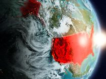 USA during sunrise. Highlighted in red on planet Earth with visible country borders. 3D illustration. Elements of this image furnished by NASA Royalty Free Stock Photography