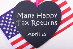 USA Tax Day blackboard and flag. Stock Images