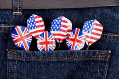 USA and UK darts in jeans pocket Stock Images