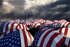 USA Umbrella Flags 01. A sea of American flags on umbrellas in a heavy rain storm. A conceptual image about tough times in the USA Stock Images
