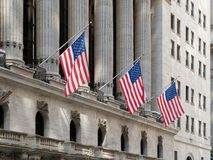 Usa flags waving in Financial District Wall Street Manhattan New York City. Usa or Us flags waving in Financial District Wall Street Manhattan New York City Royalty Free Stock Photo