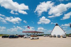 GAs Station in USA with lots of wide open space and american flag blowing in wind stock photos
