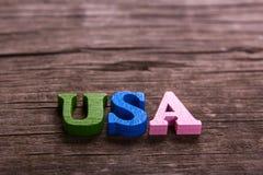 USA uttrycker gjort av träbokstäver fotografering för bildbyråer