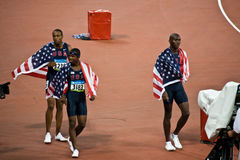 USA victory Lap Mens 400m Hurdles. Angelo Taylor , Kerron Clement , and Bershawn Jackson take a victory lap after USA sweeps men�s 400 meter hurdles with Gold Royalty Free Stock Photos