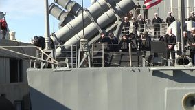 USA Virgina Norfolk, November 2015, Back Of USS. A soldier of the USS Anzio solve a rope at the back of the ship stock footage