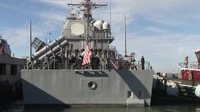 USA Virgina Norfolk, November 2015, Back Of USS. A soldiers of the USS Anzio solve a rope at the back of the ship stock footage