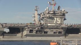 USA Virgina Norfolk, November 2015, Medium Shot Of. Soldiers stand in a formation at the deck of the USS Harry Truman Carrier. The Carrier drive out of the stock footage