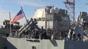 USA Virgina Norfolk, November 2015, Rear USS Anizo. US Marine soldiers stand at the rear of the USS Anizo while the ship lies at Norfolk harbour stock footage