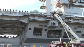 USA Virgina Norfolk, November 2015, A tilt over. A tilt over the side of the USS Harry Truman Carrier which lies at a US Harbour stock video footage