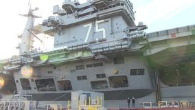 USA Virgina Norfolk, November 2015, Tilt Over USS. A tilt over the side of the USS Harry Truman Carrier which lies at a US Harbour stock video footage