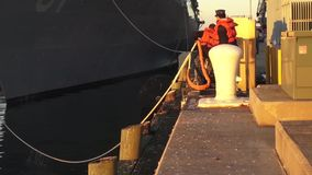 USA Virgina Norfolk, November 2015, USA USS Remage. US soldiers slacken the ropes of the USS Remage stock video