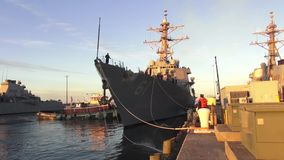 USA Virgina Norfolk, November 2015, USA USS Remage. US soldiers slacken the ropes of the USS Remage at sunset stock video footage