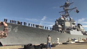 USA Virgina Norfolk, November 2015, USS Bulkeley. The USS Bulkeley drvies away from the peer. US Marine soldiers stand in formation on the ship deck stock video footage