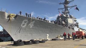 USA Virgina Norfolk, November 2015, USS Bulkeley. US Marine soldiers work on the deck of the USS Bulkeley. They haule the ropes. Others walk along the peer in stock video