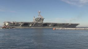 USA Virgina Norfolk, November 2015, Wide Shot Of. Soldiers stand in a formation at the deck of the USS Harry Truman Carrier. The Carrier drive out of the harbour stock footage