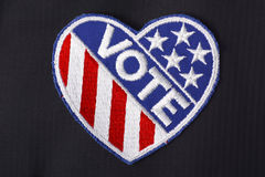 USA Vote Badge on suit pocket. Closeup of USA vote badge on black suit jacket pocket Royalty Free Stock Photo