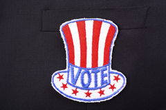 USA Vote Badge on suit pocket. Royalty Free Stock Image
