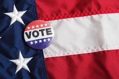 USA Voting Pin on Flag Royalty Free Stock Image
