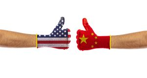 USA vs China concept. US of America and China flags gloves isolated on white background, clipping path. USA vs China, trade war. US of America and China flags royalty free stock photo