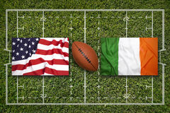 USA vs. Ireland flags on rugby field Stock Image