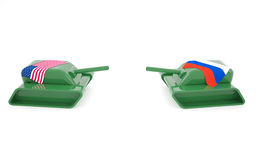 Usa vs Rus. Tension between America and Russia with two tanks facing each other Royalty Free Stock Photography