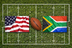 USA vs. South Africa flags on rugby field. USA vs. South Africa flags on green rugby field Royalty Free Stock Image