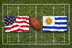 USA vs. Uruguay flags on rugby field Royalty Free Stock Photography