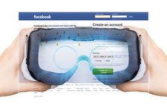 USA, Washington - August 24: 2016 Woman register with a social network Facebook. In virtual reality the assistance of Royalty Free Stock Photos